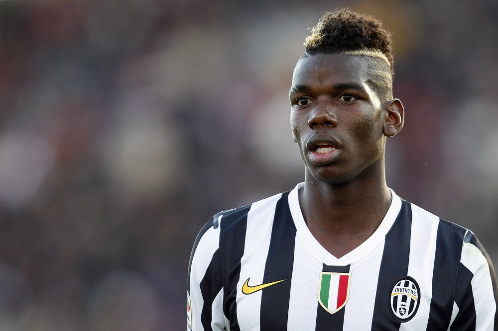 Juventus' Pogba looks on during their Italian Serie A soccer match against Livorno in Livorno