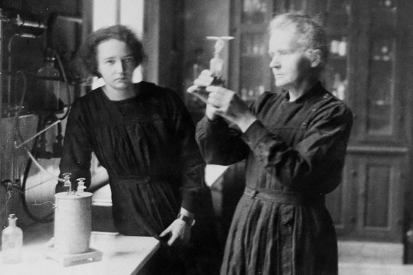 Scientist Marie Curie and daughter, Irene, working in the ra