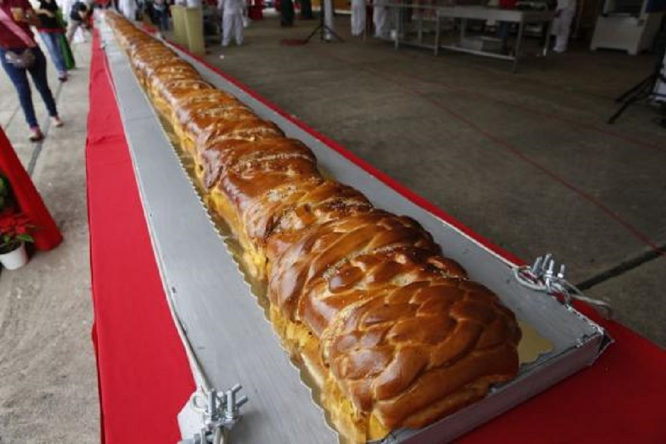A giant ham bread is seen on a table during an attempt to break the Guinness World Record for the biggest ham bread, in Caracas
