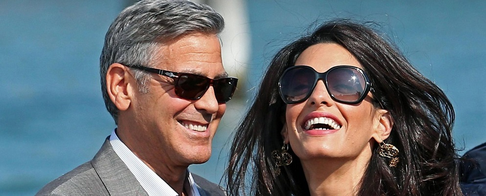 epa04418415 RECROP OF epa04418382 US actor George Clooney (L) and his fiance, Lebanese-British lawyer Amal Alamuddin (R) arrive in Venice, Italy, 26 September 2014. According to media reports, the wedding of George Clooney and Amal Alamuddin is to take place in Venice this weekend.  EPA/ALESSANDRO DI MEO